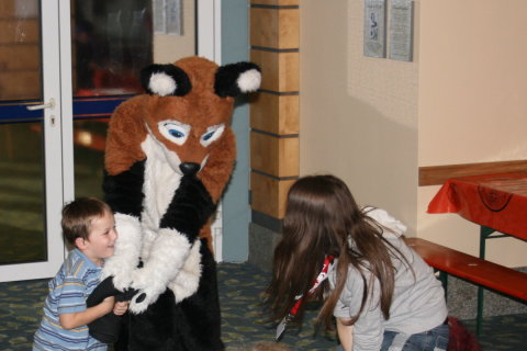 Kid playing with Eos and Fursuiter
